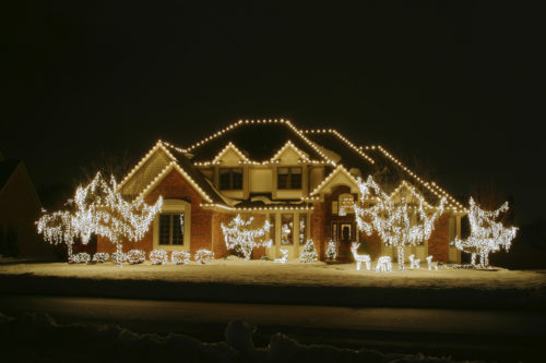 Night Christmas House 2. House is outlines and trees and yard decor lights included. Along the lower edge is a faint outline of a snow bank along the road.