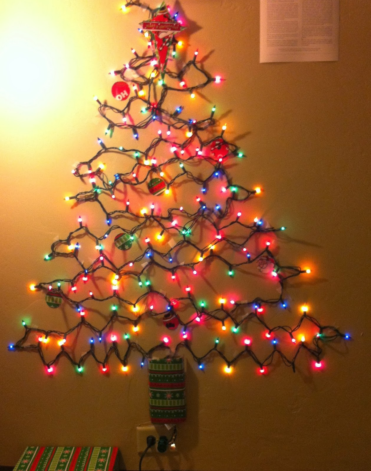 christmas tree made of lights on wall photo - 1