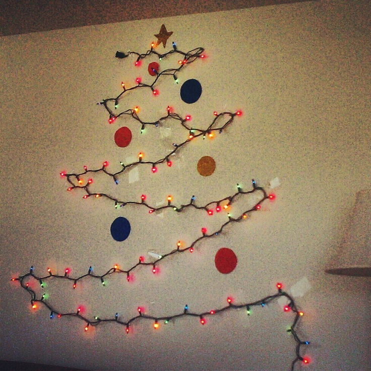 christmas tree made of lights on wall photo - 4