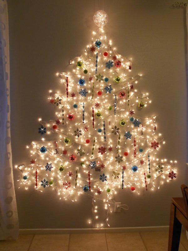 christmas tree of lights on wall photo - 8