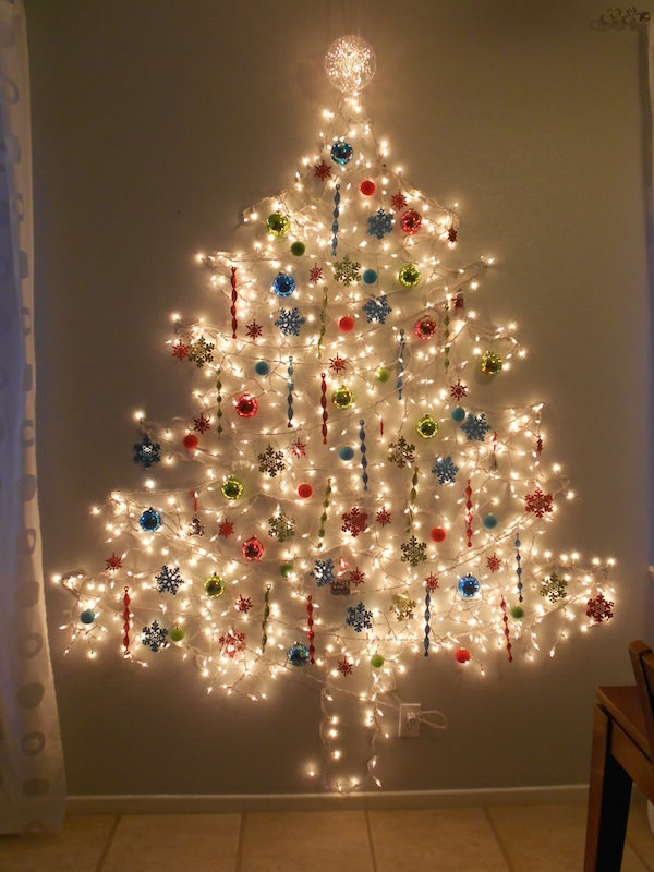 christmas tree on wall with lights photo - 1