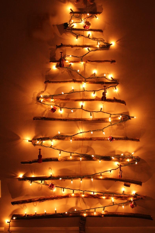 light tree on wall photo - 1