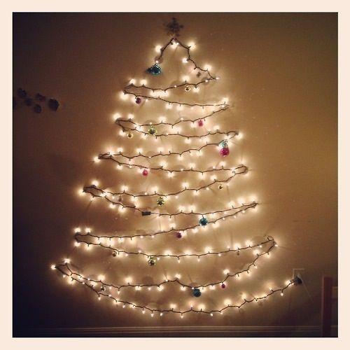 light tree on wall photo - 3